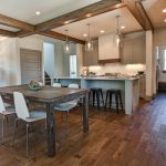 engineered hardwood flooring pros and cons in dining and kitchen ideas with rustic wooden table and white chair plus white cabinets and jar lighting fixtures