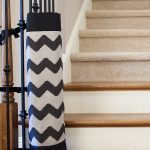fashionable cchevron patterned baby gate for top stairs design tied to black metal gate beneath concrete staircase