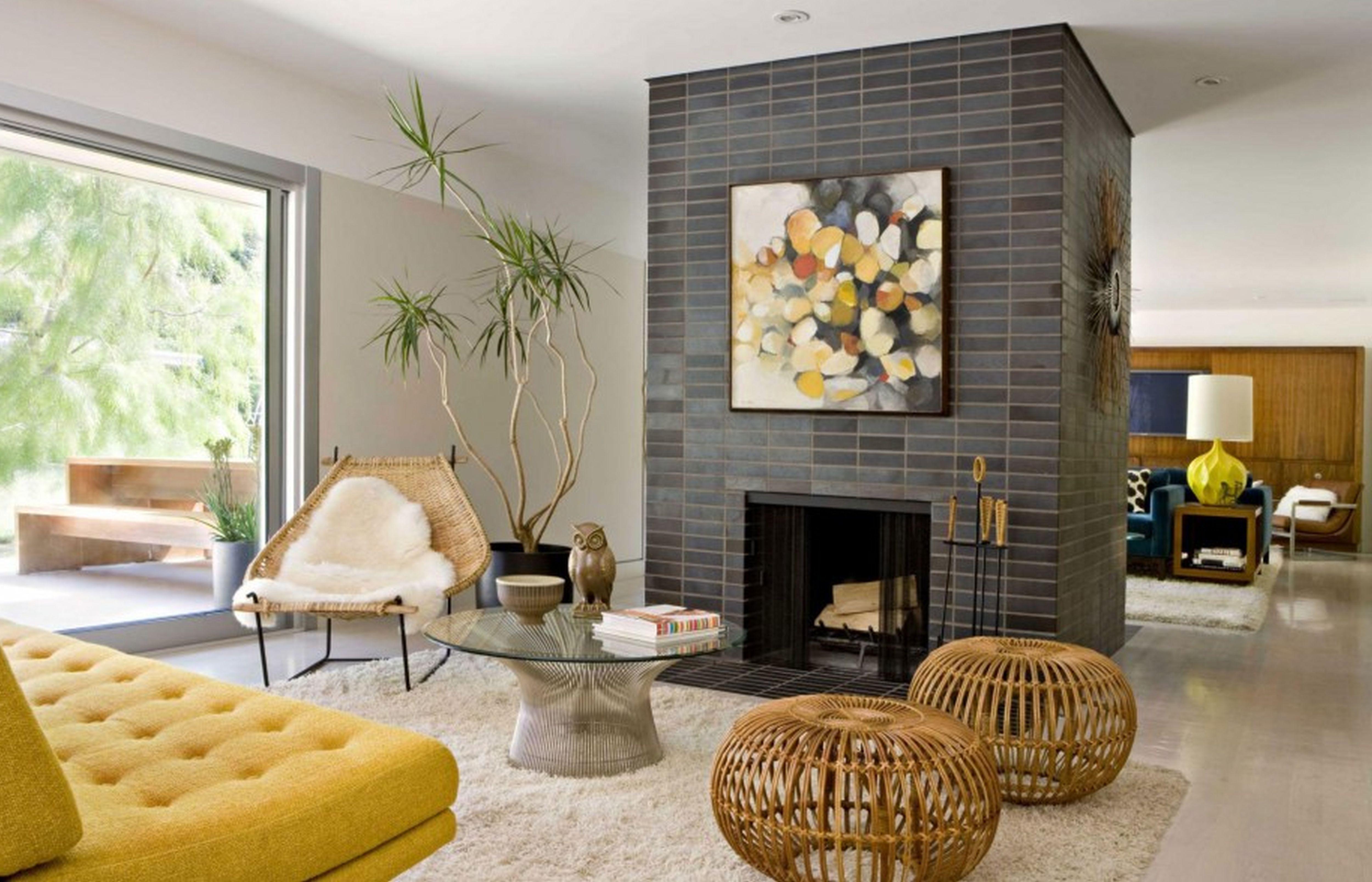 Fireplace Stone Sofa Rug Chair Table Lamp Books