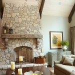 fireplace table candles sofas rug lamp