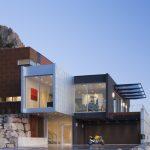 Fleetwood Windows And Doors Futuristic Modern Luxurious House Natural Huge Stones Piles Yard Green Nature