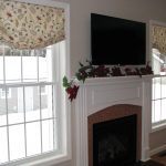 flower motive soft beige outside mount roman shades for modern living room with TV and decorative fake flower