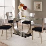 frameless glass top dining table modern metal dining chairs with black cushions white wool rug for dining room