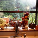 garden windows for kitchens with impressive autumn theme beautified with fresh fruits and candles and others plus modern faucets