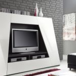 geometrical shaped idea for tv stand in white tone beneath gray brick wall before modern living room seating