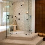 glass enclosed showres modern beige tile walls bathroom