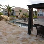 gold travertine pavers pool deck natural stone piles black wooden backyard patio cover outdoor furniture