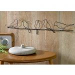 gorgeous 3D birds on wire wall art idea made of wire on wooden wall above wooden table with artificial radio and ceramic