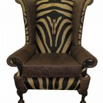 gorgeous animal print wingback chair slipcover idea with brown leather accent and carved wooden legs