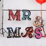 gorgeous glamor large decorative letters design in MR and Mrs spelling and red and green and blue and pink with sweet crystal decoration
