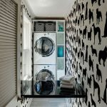 gorgeous narrow laundry room desgn with animal print pattern on the wall with black fold down laundry table