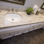 Gorgeous Vintage Classic Bathroom Vanity Design With Double Sinks And Faucet And  River White Granite Countertop  And Wall Mirror And Brown Tile Flooring Design