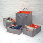grey and orange felt storage bin for clothes storage and three drawer for books or other stuff
