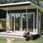 house plan for small house design in gray color with open plan and front porch and yellow seating and concrete flooring