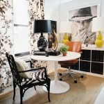 ikea tulip table decorated in with armchairs in zebra motif plus elegant table lamp with black shade featuring wooden bookcase plus yellow and white table lamp