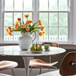ikea tulip table with marble top decorated with stylish chairs made of wood and steel plus beautiful center piece in the dining room