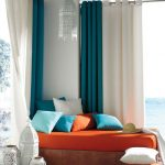 indoor outdoor curtains with the combination of blue and white decorated with day bed in orange bedding set plus colorful cushions