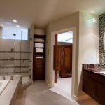 interior decorator Houston Eklektik Interiors for modern clean bathroom with two tone tile walls frameless glass shower