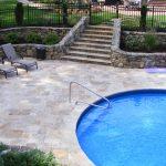 ivory travertine pavers pool deck natural limestone pavers blue round swimming pool sun bathing outdoor furniture natural stone backyard style beautiful gardening flower
