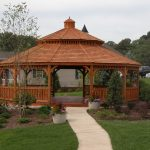 large wood gazebo kits with low walls and double roofs for large green and colorful outdoor space