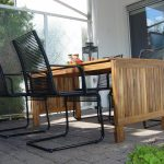 lawn furniture black chair wood table windows