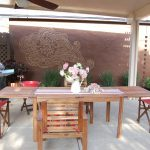 lawn furniture flowers vases chairs table fan