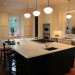 less motive white granite countertop for classic modern kitchen with wood kitchen counterstools and white cabinets white ceiling lamps and big decorative flower