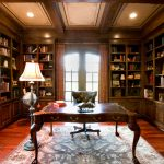 library books chair lamp table rug