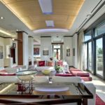 long interior design of penthouse in atlanta with open plan and red carpet and white sofa and wooden table and suspended ceiling idea