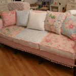 lovable pink painting fabric furniture design of long sofa with floral pattern bolster and cushions on hardwood floor