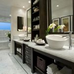 Luxurious And Large Nicole Miller Bathroom Idea In Modern Home Decor With Wooden White Vanity And Black Framed Wall Mirror With White Bowl Sink And Lily Decoration