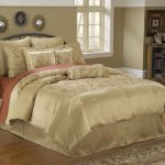 luxurious bedding set with high end linens and comfy pillow decorated with hardwood floor and rug plis antique wooden sideboard plus pictures frames on wall