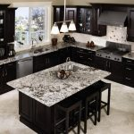 luxurious black white granite countertop for black and white tone modern sleek kitchen with three heads ceiling lamp