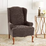 luxurious gray velvet with sheer patter wingback chair slipcover with wooden legs and metal glass side table and decoration and cream rug and white wall