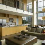 Luxurious Penthouse In Atlanta With Open Plan And Double Height Interior And Evening Hue Sofa And Yellowish Kitchen Set