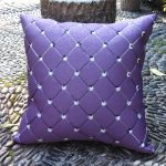 luxurious purple accent pillow design with diamond shape patterned with sparklin crystal decoration