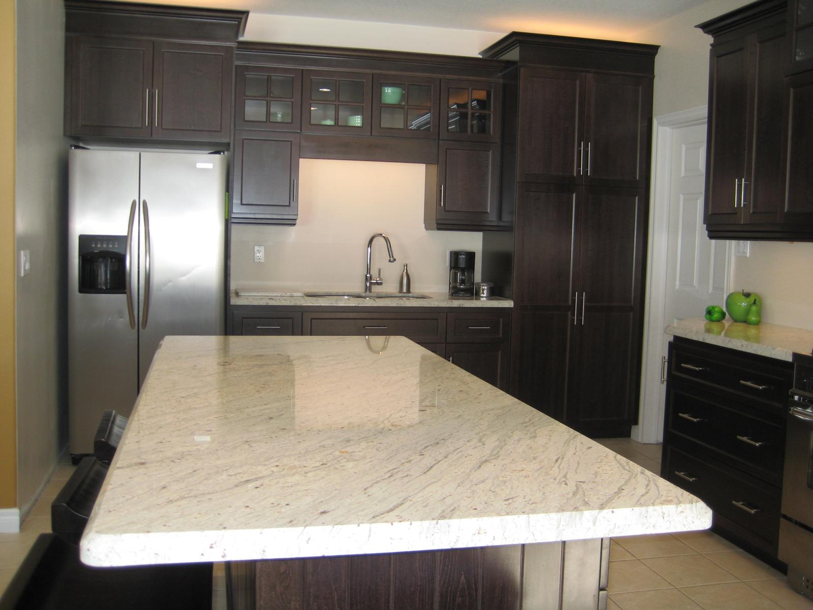 Luxurious River White Granite Countertop Design In Clic Kitchen With Black Wooden Cabinetry And Island