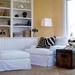 luxurious white pottery barn sofa slipcover idea with rustic industrial end table and white storage and floor lamp and orange wall