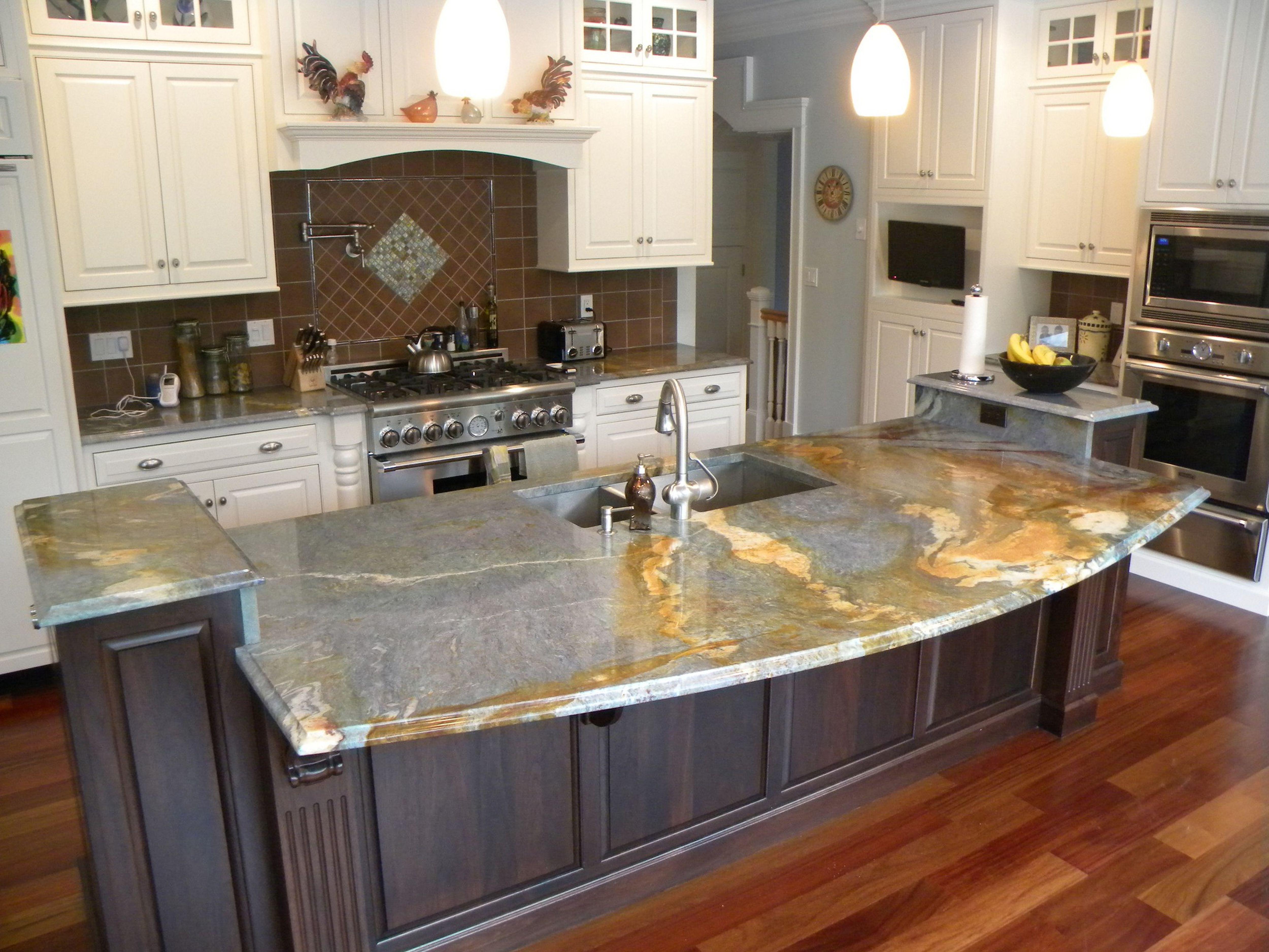 Delicieux Marble Kitchen Countertop White Cabinet Elegant Chandelier Steel Sink