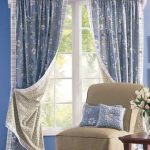 matched blue tone window treatment for small windows decorative white flower blue cushions and beige chair