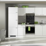 minimalist white avanti compact kitchen design with black accent of modern stove top and floor to ceiling window