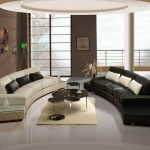 modern living room ideas with most comfortable sofas black and white in curve shape and round coffee table and small rug underneath.