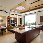 Modern Penthouse In Atlanta With Open Plan And Kitchen Table And Wooden Ceiling And Yellowish Couch And Wooden Floor