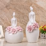 modern simple wedding gifts of ceramic bride art in white with flower accent on it