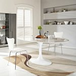modern white sleek small oval dining table with white metal frame dining  decorative flower clean white modern chair with two tones brown carpet
