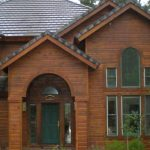 natural brown wood siding for home simple classic house green tress