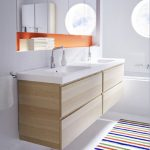 natural wooden ikea bath cabinet design with two white sinks and wall mirror with orange accent with runner rug and pendant