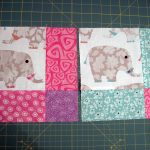 nice baby quilt to make idea in pink white and blue pantone with elephants pattern on the surfase