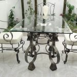 outdoor wrought iron kitchen table with rectangular glass top and stylish chairs with wrought iron and white fabric plus mesmerizing tile for flooring
