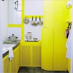 pan stove sink cabinet yellow hand towel